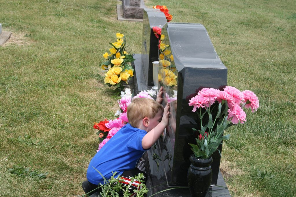 Kissing a headstone